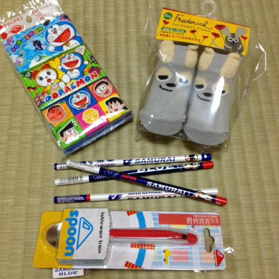 Various useful items: blue samurai pencils (for me), bullet train spoon, socks and doraemon napkins (for Saku)